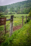 Fence in a Meadow. This fence ran between a National Park and a horse pasture to keep the horses in and visitors out Stock Photography
