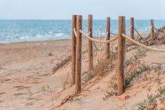 Fence on a mediterranean beach Stock Photo