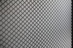 Fence mesh netting.Wire fence background. Seamless metal chain link fence. Wire fence Closeup of steel net Steel mesh Security protection Fence made from steel Royalty Free Stock Photo