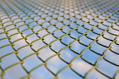 Fence with metal grid in perspective Royalty Free Stock Images