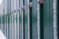 The fence of metal plates in green. royalty free stock image