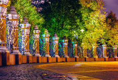 The fence of the Mikhailovsky Garden on the part of the Savior on spilled blood at night. Colorful night view of the fence of the Mikhailovsky garden near the Stock Image