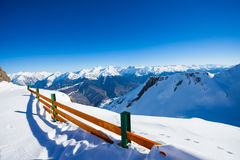 Fence and mountain panorama on winter ski resort Stock Photos