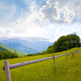 Fence in mountains Stock Photo