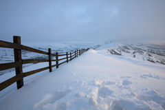 Fence in the mountains covered in snow Stock Images