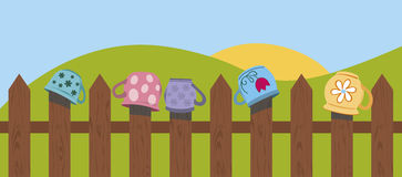 Fence with mugs Royalty Free Stock Images