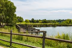 Fence Near Boat Dock at Mount Trashmore in Virginia Beach. A fence near the boat dock at Mount Trashmore Park in Virginia Beach, Virginia. The lake and city park royalty free stock photography