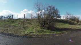 Fence near road. Camera on steadicam on road by fence hill stock footage