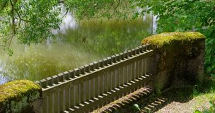 Fence near water Royalty Free Stock Images