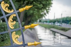 Fence next to Neva river in Saint Petersburg stock photography