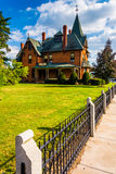 Fence and old house in Spring Grove, Pennsylvania. Stock Images