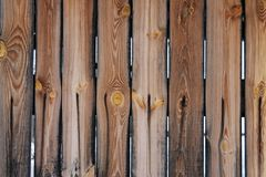 Fence of old unpainted boards for a background. Closeup Stock Photo