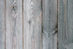 Fence of old unpainted boards for a background. Closeup Stock Photos