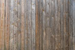Fence of old unpainted boards background closeup