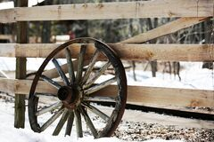 Fence & Old Wheel Stock Photography