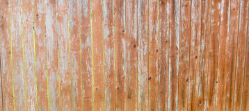 A fence of old wooden slats. Background of vertical old boards. Natural material stock photos