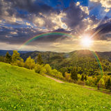 Fence On Hillside Meadow In Mountain At Sunset Royalty Free Stock Photography
