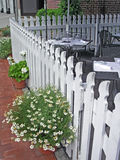 Fence at outdoor restaurant. Fence and flowers at a restaurant Royalty Free Stock Photography