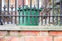 Fence over brick wall Royalty Free Stock Photos