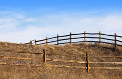 Fence Over the Top of a Hill With Gate Royalty Free Stock Images