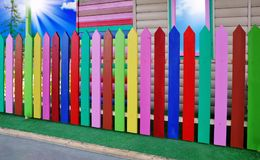 The fence is painted with paints of different colors Stock Photography