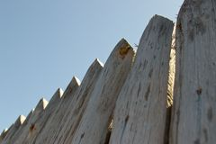 Fence, palings of unrefined wood. The Russian village Stock Images