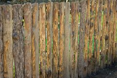Fence, palings of unrefined wood. The Russian village Royalty Free Stock Photos