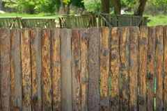 Fence, palings of unrefined wood. The Russian village Royalty Free Stock Photography