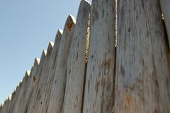 Fence, palings of unrefined wood. royalty free stock images