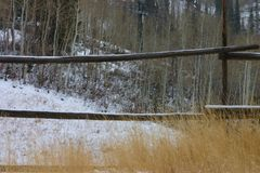 The Fence. This is in Park City, Utah very close to the ski slope. The snow was not very deep, just a coating in the field and on the fence Stock Images