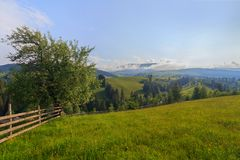 Fence of a pasture and mountain royalty free stock image