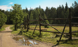 Fence pastures next to the road. Island Valaam. Russian North. Fence pastures next to the road Stock Photos