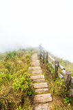Fence and pathway on mountain. Old wood fence and pathway on mountain with fog Stock Photos