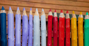 Fence of pencils. Fence made of big color pencils Royalty Free Stock Image