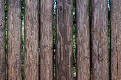 Fence from pine logs without bark. Tall, strong fence from pine logs without bark for protection and defense Stock Image