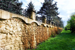 Fence placed a long brick wall. Royalty Free Stock Photo
