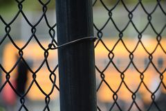 Fence Pole with School Bus in Background royalty free stock photo