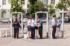 Fence with police frames metal detectors at the central square i. SAMARA, RUSSIA - JUNE 12, 2015: Fence with police frames metal detectors at the central square royalty free stock photos