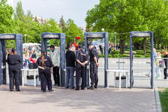 Fence with police frames metal detectors at the central square. SAMARA, RUSSIA - MAY 8, 2016: Fence with police frames metal detectors at the central square in stock photo