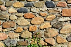 A fence of poorly processed natural stone. The fence in the Park for the separation of recreation areas Stock Photo