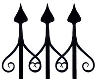 Fence posts with artfully formed tips,. Pattern made by three iron fence posts with artfully formed tips, isolated,seamless Royalty Free Stock Photos