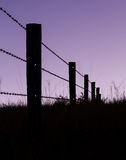 Fence Posts in Silhouette. As the sun goes down, Mount Barney National Park, Queensland, Australia Stock Photo