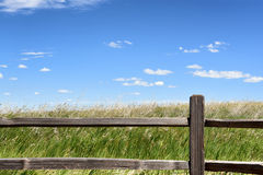 Fence and Prairie Grass. Badlands National Park. The park's 244,000 acres protect an expanse of mixed-grass prairie that support bison, bighorn sheep, prairie Stock Photography