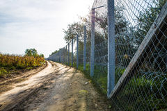 The fence protecting the border between Hungary and Serbia. ROESZKE, HUNGARY - SEPTEMBER 15: View on the 175km long fence between Hungary and Serbia installed Stock Photo