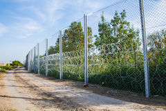 The fence protecting the border between Hungary and Serbia. ROESZKE, HUNGARY - SEPTEMBER 15: View on the 175km long fence between Hungary and Serbia installed Stock Image