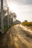 The fence protecting the border between Hungary and Serbia. ROESZKE, HUNGARY - SEPTEMBER 15: View on the 175km long fence between Hungary and Serbia installed Royalty Free Stock Image