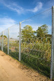 The fence protecting the border between Hungary and Serbia. ROESZKE, HUNGARY - SEPTEMBER 15: View on the 175km long fence between Hungary and Serbia installed Royalty Free Stock Photos