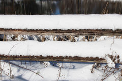 Fence rails covered in heavy snow Stock Images