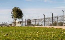 Fence with razor wire stock photos