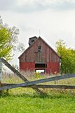 Fence and Red Barn Stock Photography